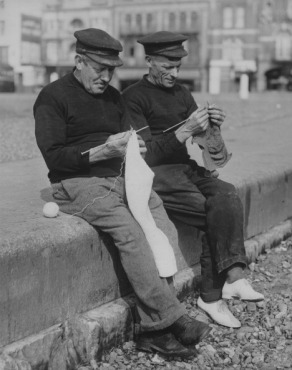 Two Men Knitting Outdoors